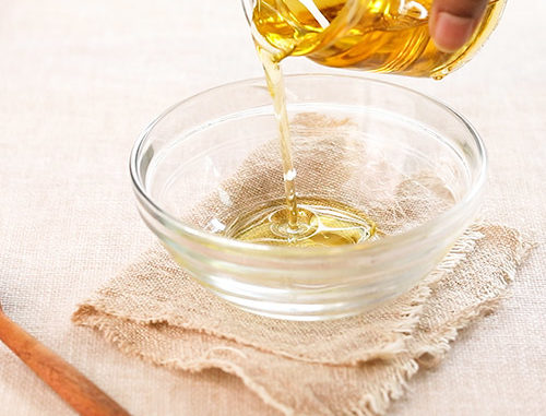 FIGHT ACNE AND FINE LINES WITH OIL CLEANSING